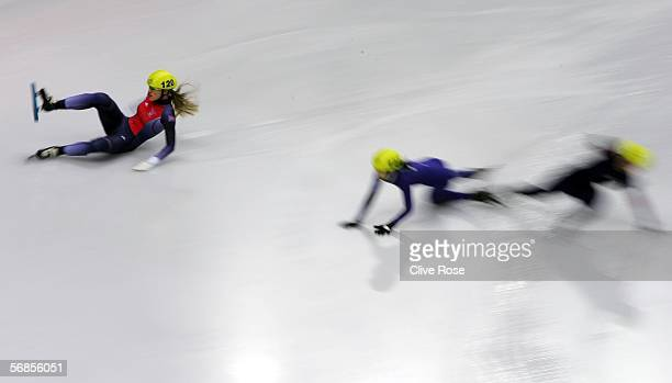 Sarah Lindsay of Great Britain slides off and into the barriers and fails to qualify in the women's 500m Short Track Speed Skating Quarter Final...