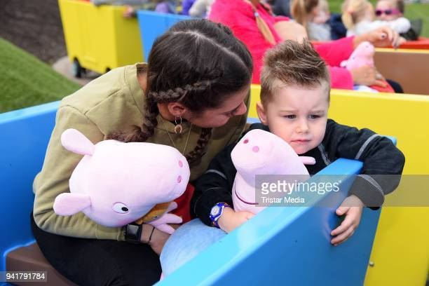 Sarah Lombardi and her son Alessio Lombardi test the new kids area 'Peppa Pig Land 'at Heide Park Resort theme park on April 4 2018 in Soltau Germany