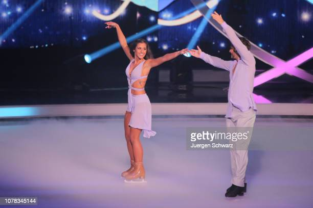 Sarah Lombardi and Joti Polizoakis perform during the 1st live show of the new dance competition television series 'Dancing on Ice' at MMC Studios on...