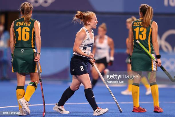 Sarah Louise Jones of Team Great Britain celebrates their team's first goal, scored by team mate Elena Sian Rayer during the Women's Preliminary Pool...