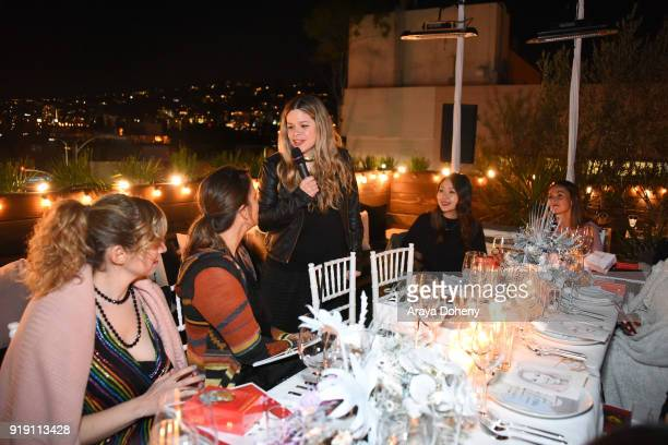 Sarah Loyer Andrea Corradini Georgina James and Grace Chang attend the Flaunt Magazine Dinner with Nike and Revolve on February 15 2018 in Los...