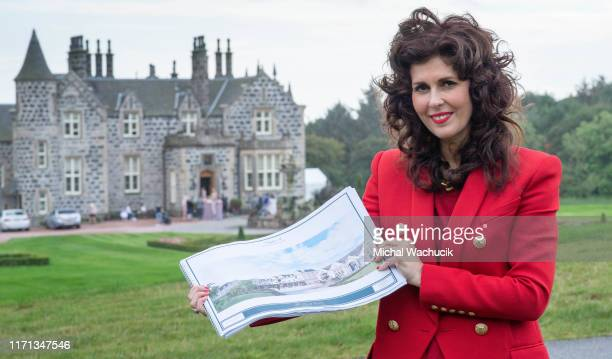 Sarah Malone, executive vice-president of Trump International Golf Links Scotland, poses with plans for the expansion of the Menie Estate on...