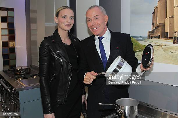 Sarah Marshall and fashion designer Jean-Claude Jitrois attend a traditional craftsman food tasting at La Cornue boutique on November 30, 2012 in...