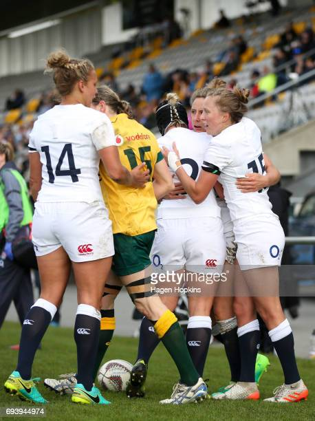 Sarah McKenna of England celebrates her try with Kay Wilson Rachael Burford and Emily Scott during the Women's International Test match between the...