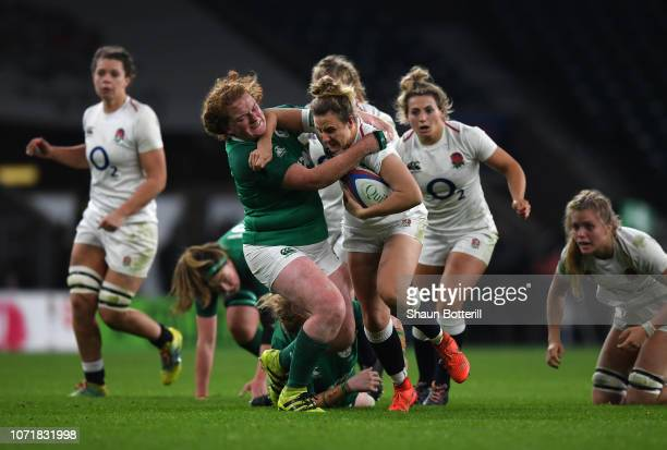 Sarah McKenna of England is tackled by Fiona Reidy of Ireland during the Women's Quilter International match between England Women and Ireland Women...