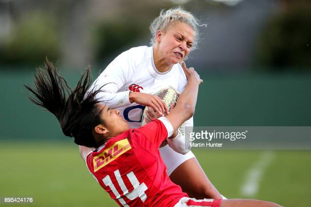 Sarah McKenna of England is tackled by Magali Harvey of Canada during the Women's International Test match between Canada and the England Roses at...