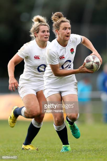 Sarah McKenna of England makes a break with Vicky Fleetwood in support during the Women's International Test match between the Australian Wallaroos...