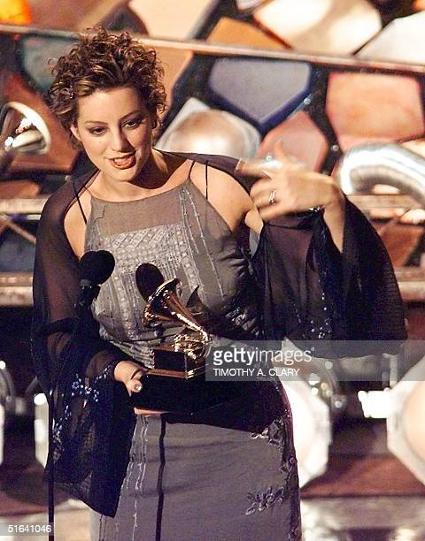 Sarah McLachlan holds up her Grammy Award for Best Female Pop Vocal Performance during the 40th Grammy Awards at Radio City Music Hall in New York 25...