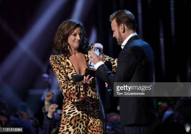 Sarah McLachlan presents Corey Hart with an award for induction into the Canadian Music Hall of Fame during the 2019 Juno Awards at Budweiser Gardens...