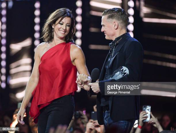 Sarah Mclachlan receives award from Bryan Adams at the 2017 Juno Awards at The Canadian Tire Centre on April 2 2017 in Ottawa Canada