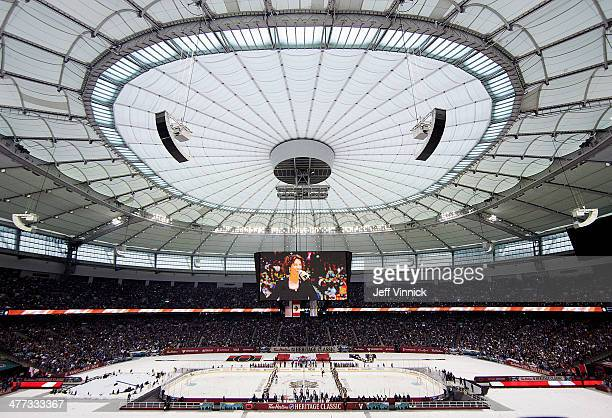 Sarah McLachlan sings the national anthem at the 2014 Tim Hortons NHL Heritage Classic between the Vancouver Canucks and the Ottawa Senators at BC...