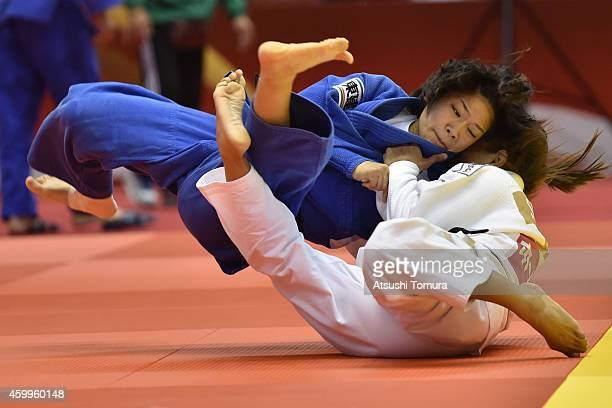Sarah Menezes of Brazil and Funa Tonaki of Japan compete in Women's 48kg during Judo Grand Slam Tokyo 2014 at Tokyo Metropolitan Gymnasium on...
