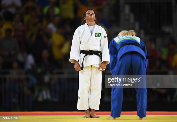 Sarah Menezes of Brazil celebrates after defeating Charline van Snick of Belgium in the women's 48 kg Judo on Day 1 of the Rio 2016 Olympic Games at...