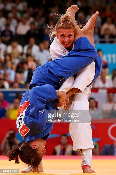 Sarah Menezes of Brazil competes against Alina Dumitru of Romania to win the gold medal in the Women's 48 kg Judo on Day 1 of the London 2012 Olympic...