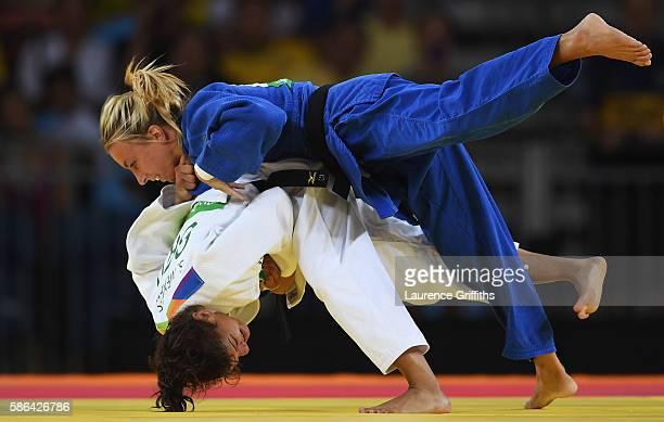 Sarah Menezes of Brazil competes against Charline van Snick of Belgium in the women's -48 kg Judo on Day 1 of the Rio 2016 Olympic Games at Carioca...