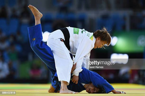 Sarah Menezes of Brazil competes against Urantsetseg Munkhbat of Mongolia during the Women's 48 kg Repechage Judo contest on Day 1 of the Rio 2016...