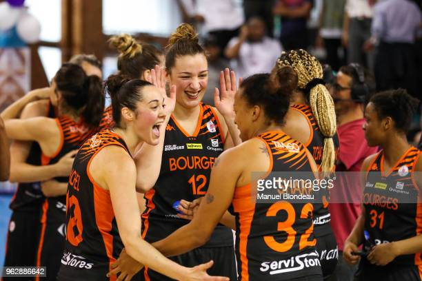 Sarah Michel and Kristen Sharp and Alexia Chartereau of Bourges celebrate victory during the Women's League playoff match between Tarbes v Tango...