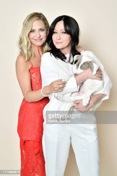 Sarah Michelle Gellar and Shannen Doherty pose for a portrait in the Getty Images People Magazine Portrait Studio at Hallmark Channel and American...