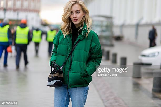 Sarah Mikaela wearing a green down feather jacket on October 15 2016 in Moscow Russia