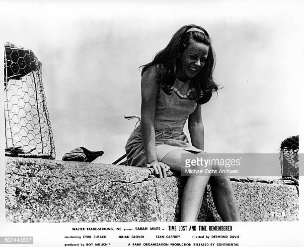 Sarah Miles a young Irish girl sits on a cement wall in a scene from the movie Time Lost and Time Remembered circa 1966