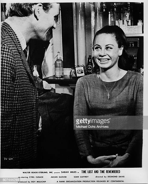 Sarah Miles and Julian Glover share a moment of laughter in a scene from the movie Time Lost and Time Remembered circa 1966