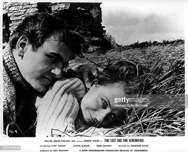 Sarah Miles and Sean Caffrey renew an old friendship on the dunes of a small town in a scene from the movie Time Lost and Time Remembered circa 1966