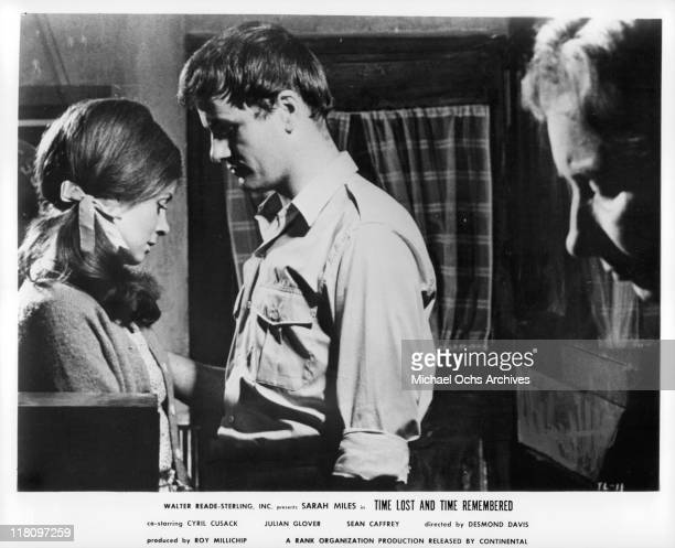 Sarah Miles and Sean Caffrey talk quietly as barkeeper Mary Kean looks on in a scene from the film 'Time Lost and Time Remembered' 1966