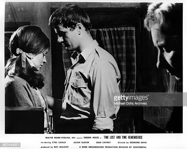 Sarah Miles and Sean Caffrey talk quietly in a small Irish pub in a scene from the movie Time Lost and Time Remembered circa 1966
