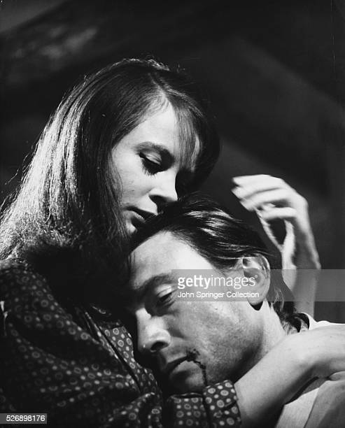 Sarah Miles as Catherine and Laurence Harvey as Sean McKenna in 1963 film The Ceremony
