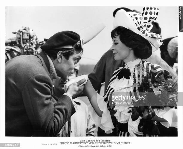Sarah Miles has her hand kissed by man in a scene from the film 'Those Magnificent Men In Their Flying Machines Or How I Flew From London To Paris In...