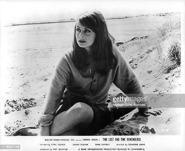 Sarah Miles sitting in the sand in a scene from the film 'Time Lost and Time Remembered' 1966