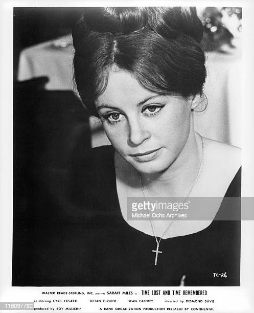Sarah Miles sitting with her hair up in a scene from the film 'Time Lost and Time Remembered' 1966