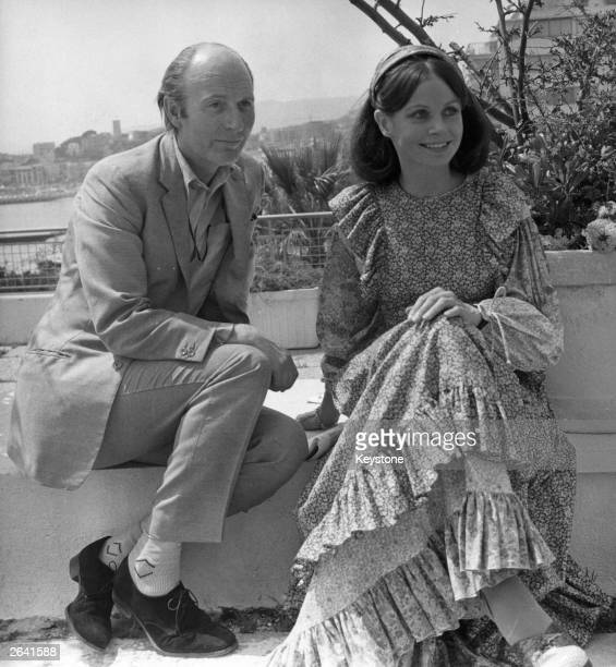 Sarah Miles the British film actress is pictured sitting by Alan Bridges the film director in Cannes Her new film 'The Hirelings' had just been...