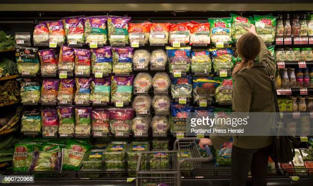 Sarah Moak grabs a bag of prepackaged romaine lettuce hearts from a shelf in the South Portland Hannaford off of Cottage Road Moak said that she...