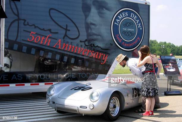 Sarah MoisonThomas and her father John Thomas of West Lafayette take a look at a replica of the Porsche Spyder 550 that James Dean was driving when...