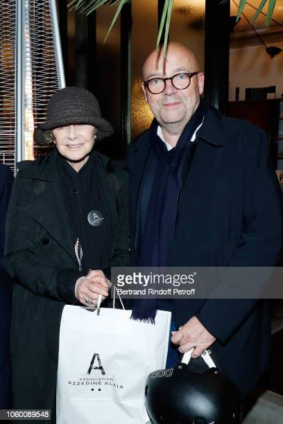 Sarah Moon and Fabrice Hergott attend Alaia Foundation Library Opening at Galery Azzedine Alaia on November 10 2018 in Paris France