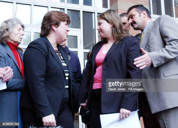 Sarah Moore and Allison Munn the widows of PC Andrew Munn and Bryan Moore leave Stafford Crown Court after Leayon Davi Dudley was found guilty of...