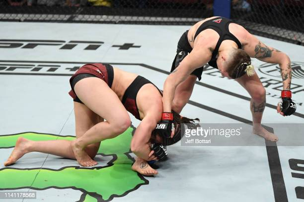 Sarah Moras of Canada attempts to take down Macy Chiasson in their women's bantamweight bout during the UFC Fight Night event at Canadian Tire Centre...