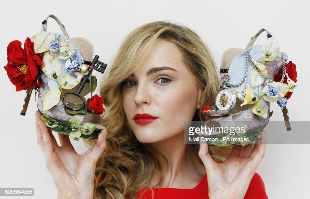Sarah Morrissey models Alice In Wonderland inspired shoes designed by British shoe designer Nicholas Kirkwood during a press preview before going on...
