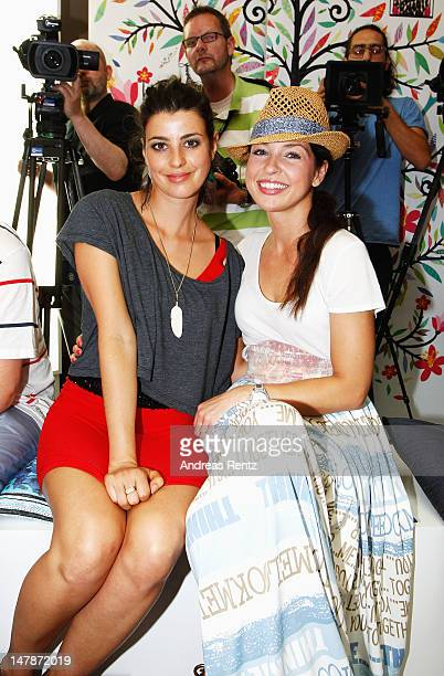 Sarah Muehlhause and Maria Wedig arrives for the Marc Cain show during the Mercedes-Benz Fashion Week Spring/Summer 2013 on July 5, 2012 in Berlin,...