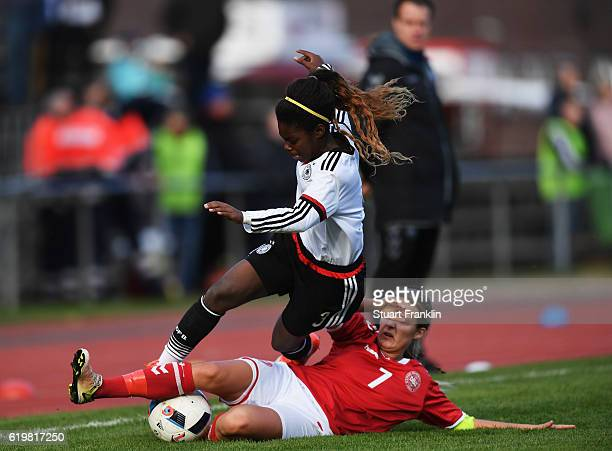 Sarah Mueller of Germany is challenged by Olivia Moeller Holdt of Denmark during the International Friendly match between U16 Girl's Germany and U16...