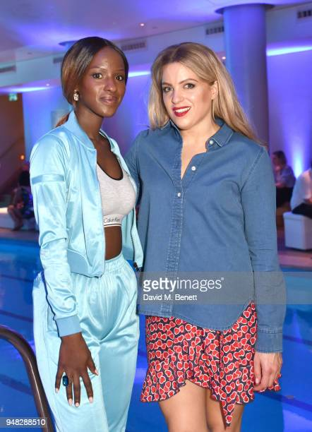 Sarah Muldinwa and Olivia Cox attend the Club St Tropez Pool Party at The Haymarket Hotel on April 18 2018 in London England