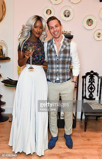 Sarah Mulindwa and Ali Samli attend the ConSept Charity Shopping Event in London at ConSept King's Road on October 13 2016 in London England