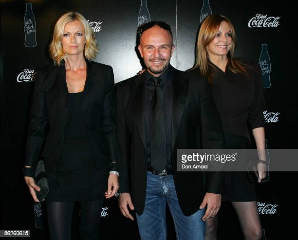 Sarah Murdoch, Alex Perry and Charlotte Dawson pose prior to the Little Black Dress show on the catwalk at the Overseas Passenger Terminal, Circular...