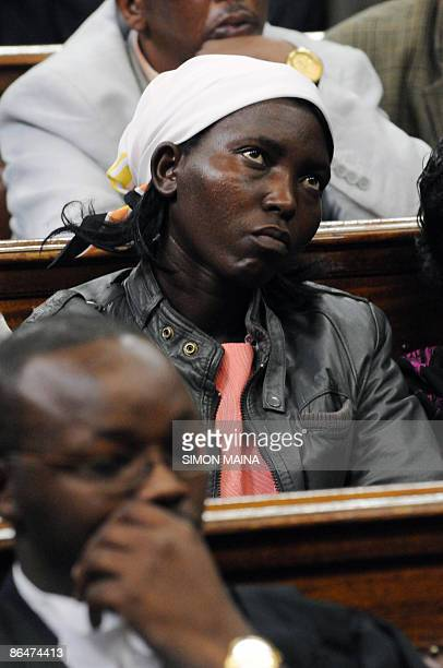 Sarah Njoya the wife of an alleged poacher shot dead by Thomas Cholmondeley the heir of Kenya's most famous white settler listens while sitting in a...