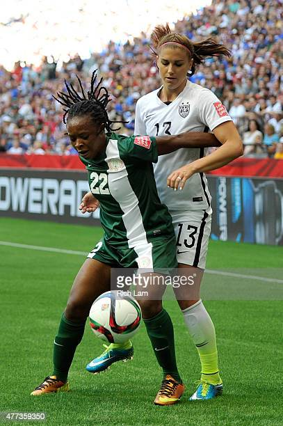 Sarah Nnodim of Nigeria controls the ball against Alex Morgan of the United States in the first half in the Group D match of the FIFA Women's World...