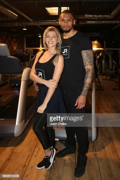 Sarah Nowak and Dominic Harrison pose during the opening of John Reed Fitness Music Club on April 10 2017 in Hamburg Germany