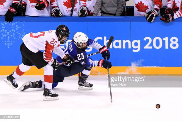 Sarah Nurse of Canada and Sidney Morin of the United States battle for the puck in the first period during the Women's Gold Medal Game on day...