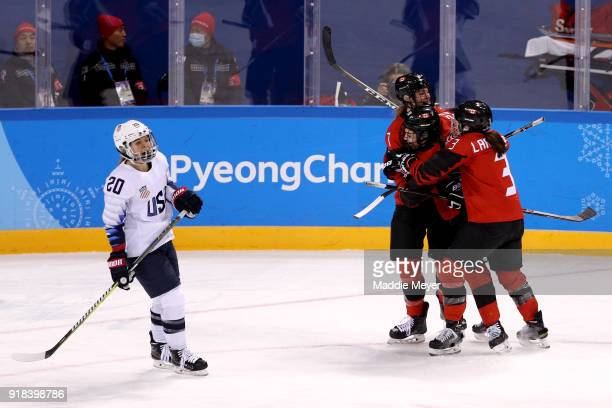 Sarah Nurse of Canada celebrates with Jocelyne Larocque of Canada and Laura Stacey of Canada after scoring in the second period as Hannah Brandt of...