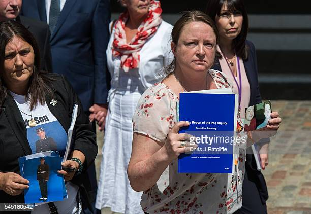 Sarah O'Connor holds a picture of her brother Sergeant Bob O'Connor who was killed in Iraq in 2005 outside the Queen Elizabeth II conference centre...